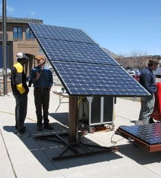 People Looking at Solar Panel