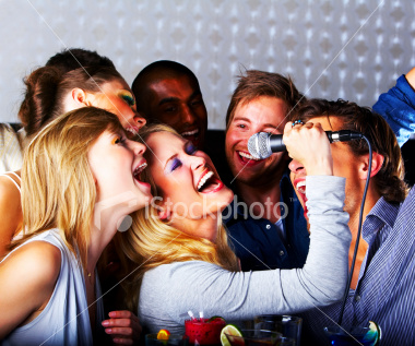 ist2_6049264-group-of-young-cheerful-people-singing.jpg