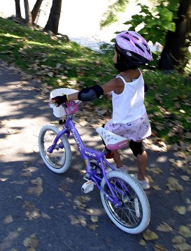 Girl riding bike with Helmet