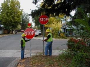 workers replacing a stop sign